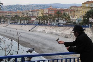 old man feeding birds in nice 300x200 - Exploring Nice, France and Nice to Rimini, Italy by train