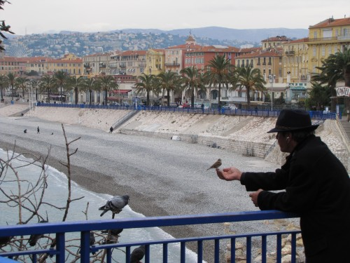 old man feeding birds in nice 500x375 - Exploring Nice, France and Nice to Rimini, Italy by train