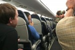 pig plane usairways 150x100 - Woman booted off flight after bringing disruptive pig aboard