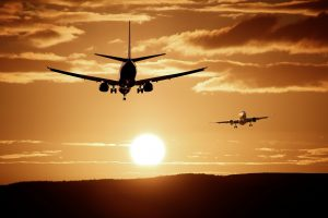 airplane sunset 300x200 - Register for transpacific airline price fixing settlement