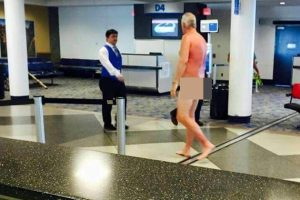 nude man airport charlotte 300x200 - Man strips naked in airport to protest overbooked flight