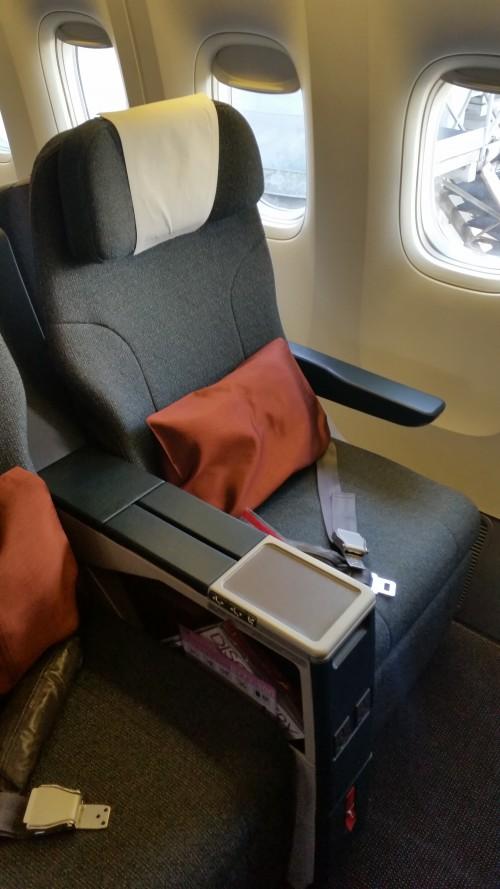 cathay pacific 777 business class regional seat 500x889 - Cathay Pacific Business Class 777-300 Hong Kong HKG to Tokyo Narita NRT: Around The World