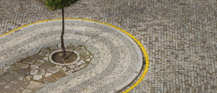 faro portugal cobblestones 700x300 - Photo of the Day: Chapel of Bones, Faro, Portugal