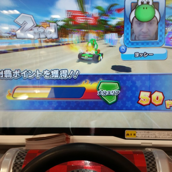 playing mario kart arcade 700x700 - Exploring the toilets, arcades, & Robot Restaurant in Shinjuku - Tokyo, Japan