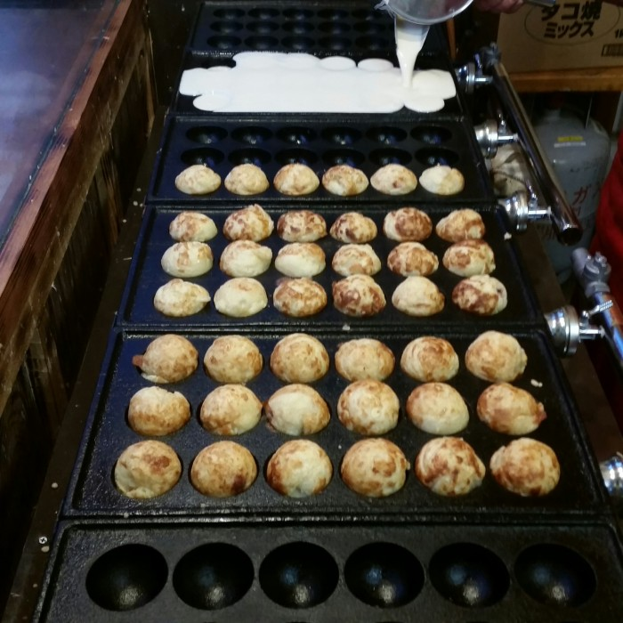 cooking takoyaki 700x700 - A visit to Ryoanji Temple, Kinkaku Temple, & Fushimi Inari Shrine in Kyoto, Japan
