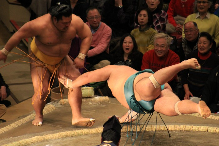 flying sumo wrestler 700x467 - Attending the Grand Sumo Tournament in Tokyo, Japan