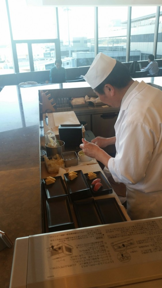 jal first class lounge sushi bar 563x1000 - Japan Airlines First Class Lounge Tokyo Narita NRT review: Around The World