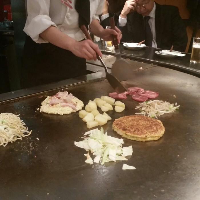 okonomiyaki grill 700x700 - A visit to Ryoanji Temple, Kinkaku Temple, & Fushimi Inari Shrine + eating takoyaki & okonomiyaki in Kyoto, Japan