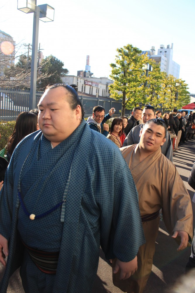 sumo wrestler parade 667x1000 - Attending the Grand Sumo Tournament in Tokyo, Japan