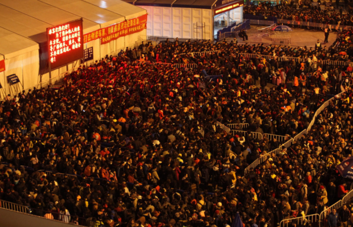 chinese new year train station crowd 700x450 - Travel nightmare: 100,000 people stuck at Chinese train station