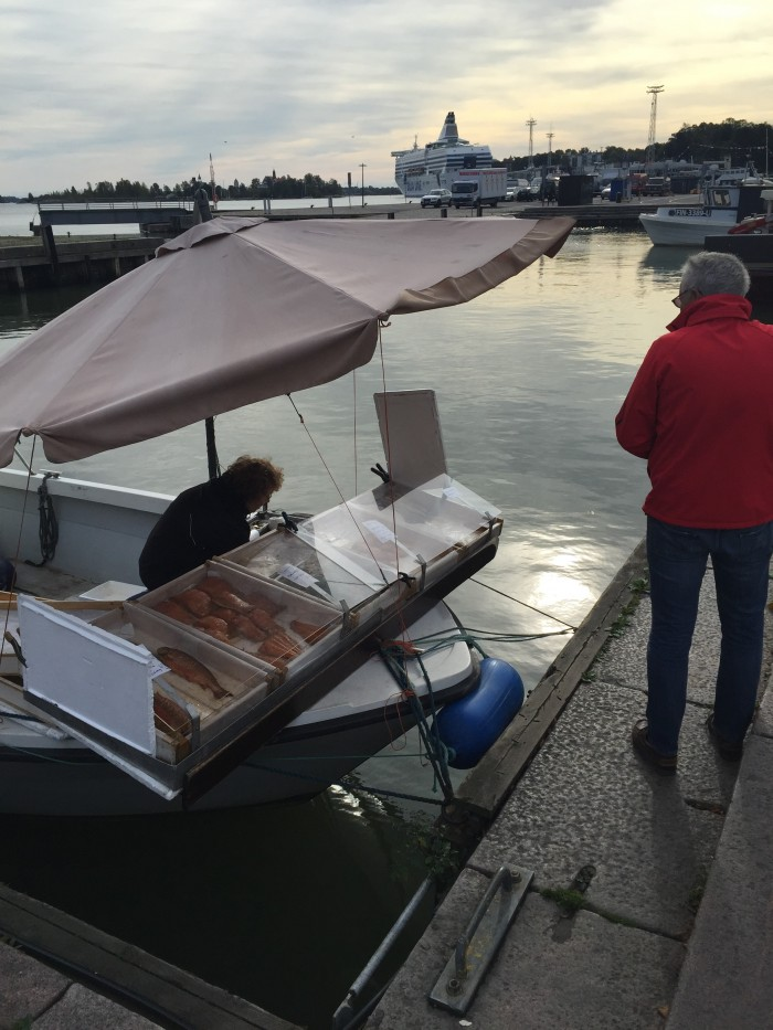 helsinki fish vendor boat 700x933 - Exploring the food markets & city centre of Helsinki, Finland