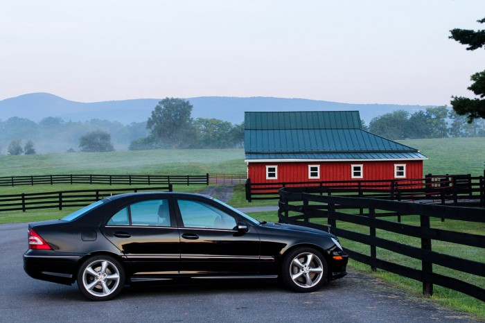 car in front of barn