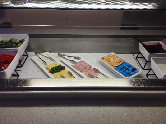 finnair lounge helsinki meat cheese 700x525 - Finnair Lounge Helsinki HEL non-Schengen review