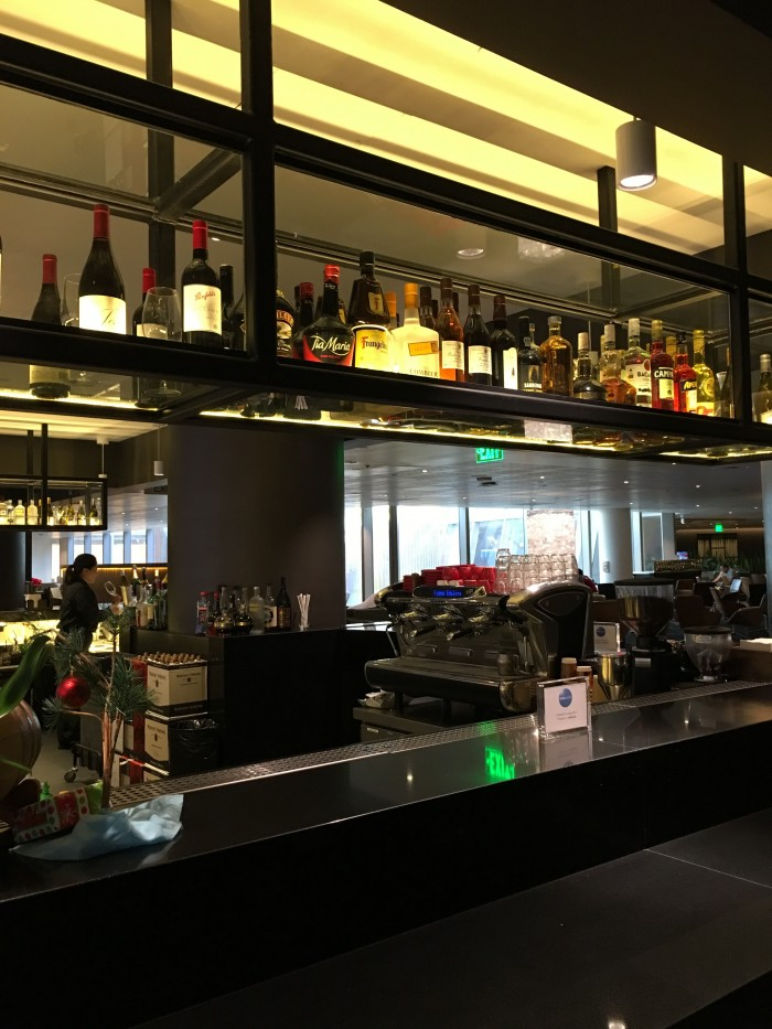 oneworld lounge lax bar 700x933 - OneWorld Business Lounge Los Angeles LAX review