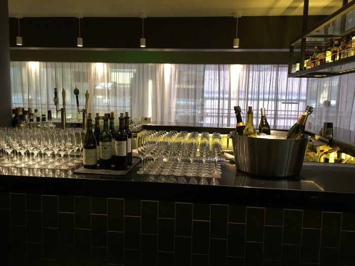 oneworld lounge lax wine champagne 700x525 - OneWorld Business Lounge Los Angeles LAX review