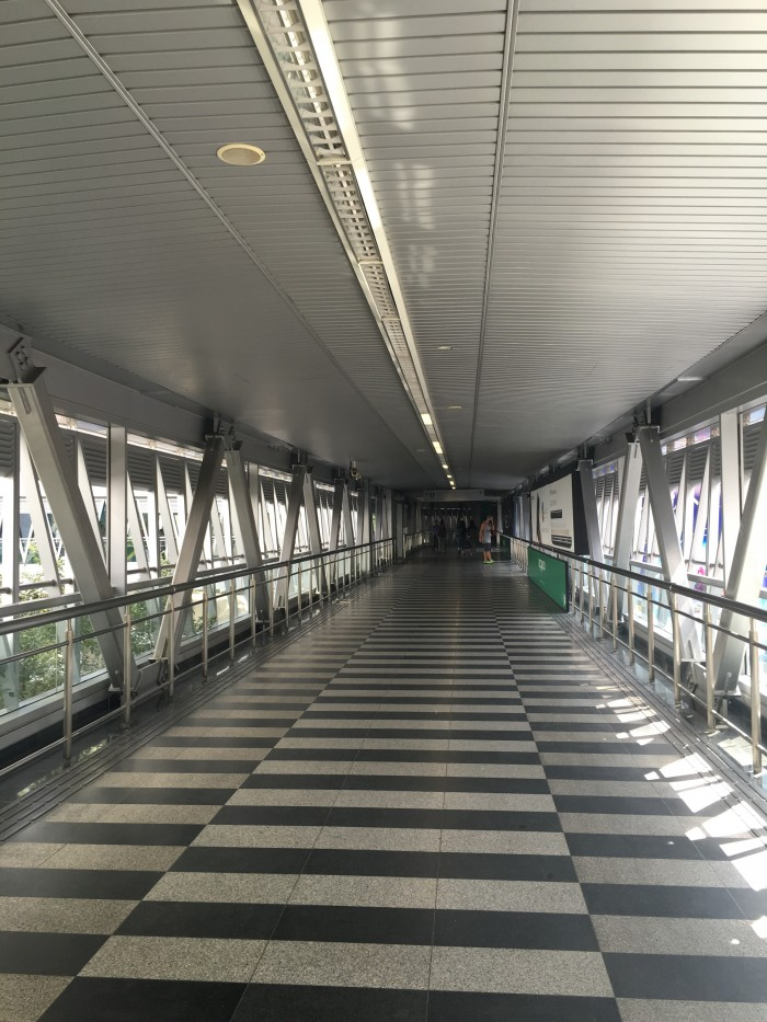 bukit bintang klcc pedestrian walkway 700x933 - A layover in Kuala Lumpur - Street markets & Petronas Towers