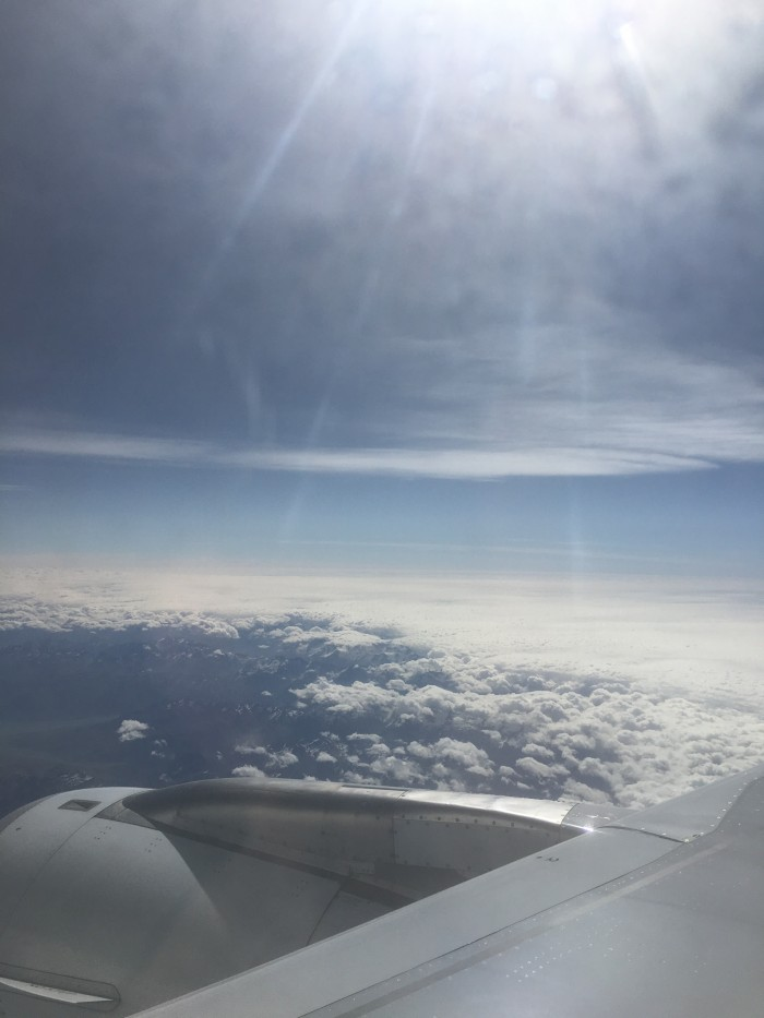 new zealand plane sun sky 700x933 - Air New Zealand Economy Class Airbus A320 Auckland AKL to Queenstown ZQN review