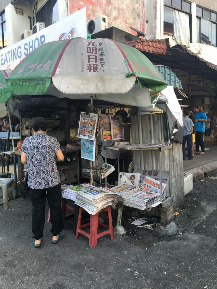 newspaper vendor kuala lumpur 700x933 - A layover in Kuala Lumpur - Street markets & Petronas Towers
