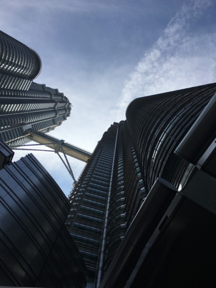 petronas towers from below 700x933 - A layover in Kuala Lumpur - Street markets & Petronas Towers