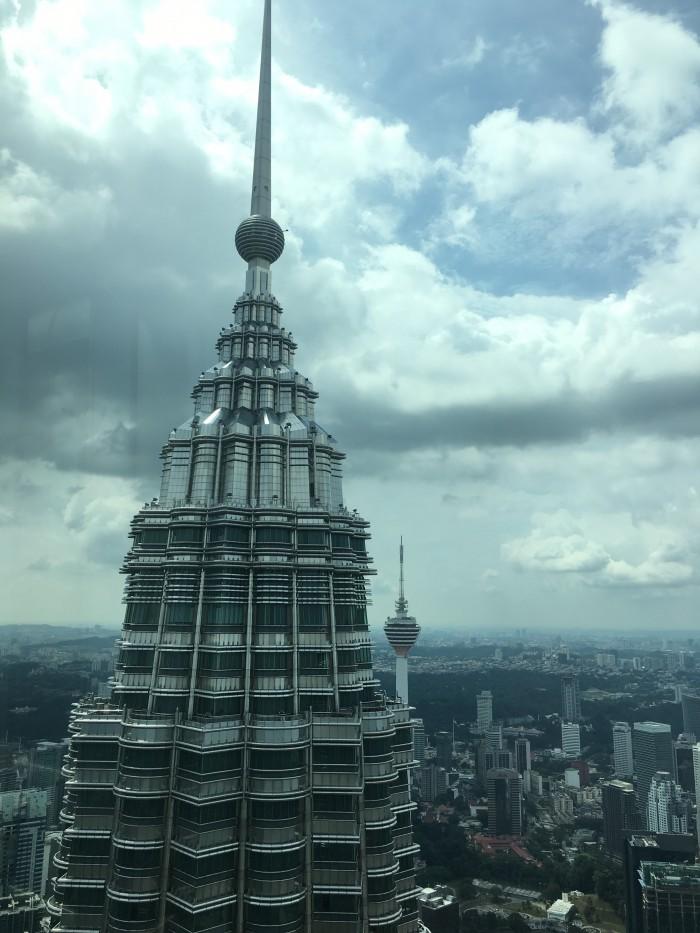 petronas towers spire 700x933 - A layover in Kuala Lumpur - Street markets & Petronas Towers