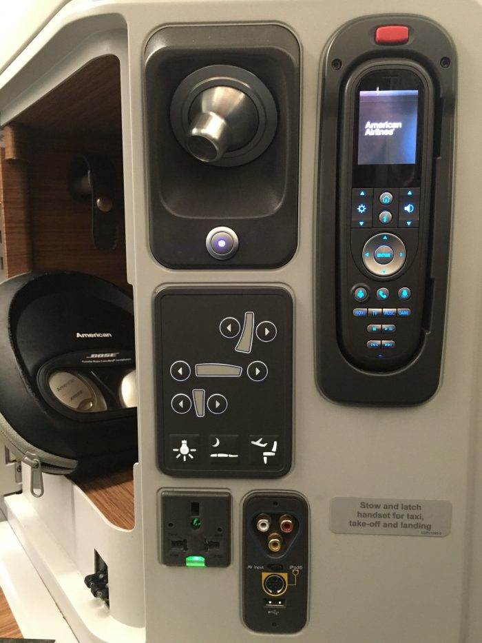 american airlines business class boeing 777 300er los angeles lax to london heathrow lhr headphones remote controls 700x933 - American Airlines Business Class Boeing 777-300ER Los Angeles LAX to London Heathrow LHR review