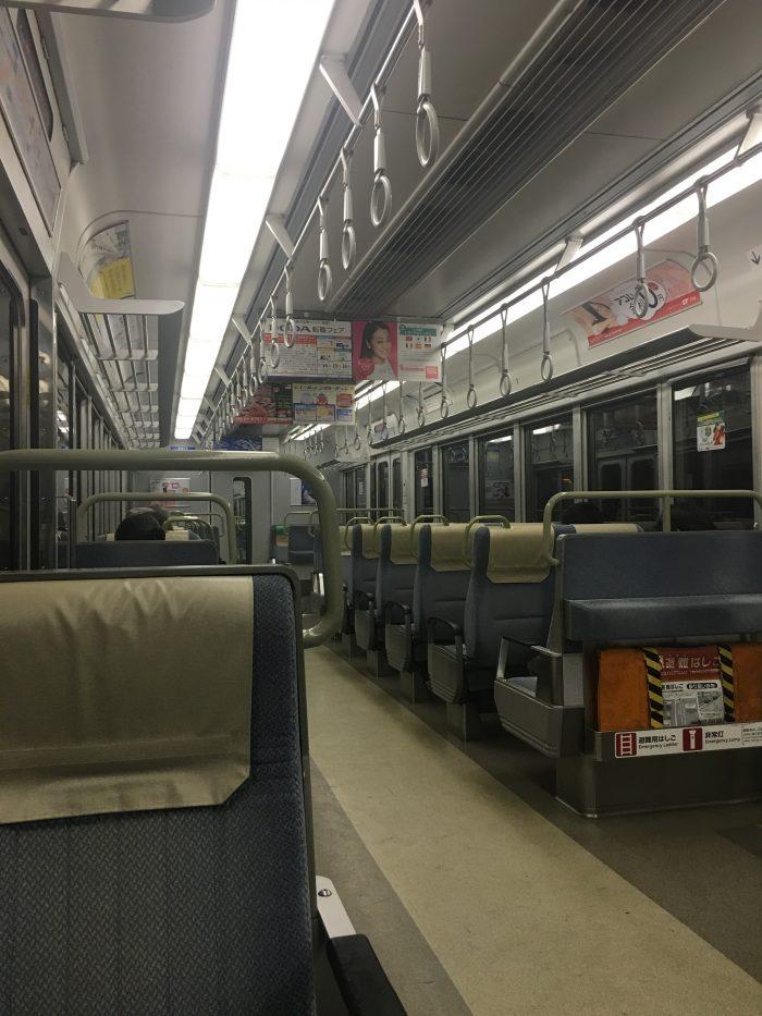 kansai to osaka train 700x933 - A layover in Osaka - Ramen, sushi, & exploring the city