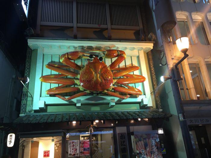 osaka crab 700x525 - A layover in Osaka - Ramen, sushi, & exploring the city