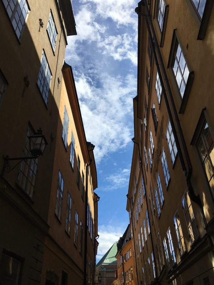 gamla stan reflections sky 700x933 - A photo walk through Gamla Stan, Stockholm's Old Town
