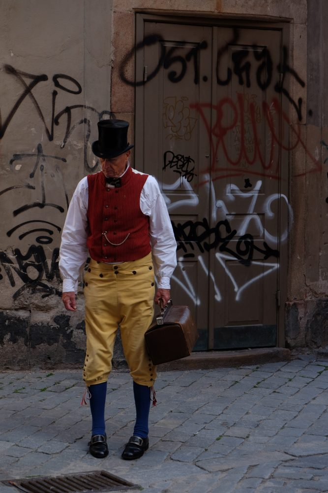man in costume graffiti stockholm 667x1000 - A photo walk through Gamla Stan, Stockholm's Old Town