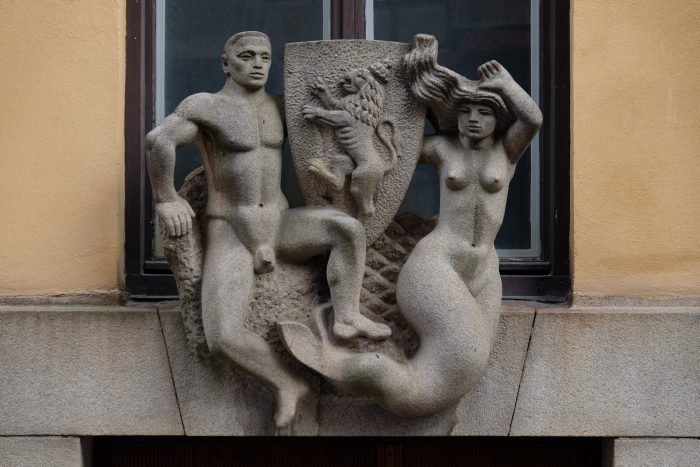 naked guy mermade carving stockholm 700x467 - A photo walk through Gamla Stan, Stockholm's Old Town