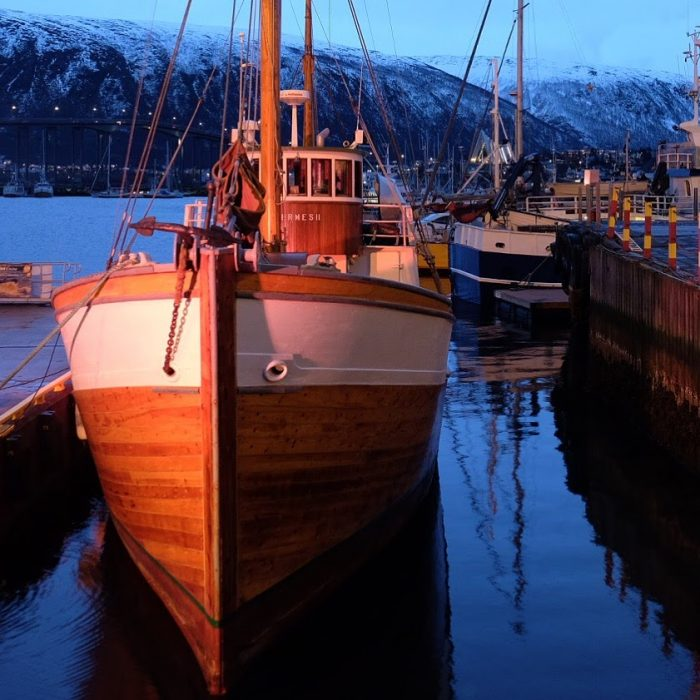 tromso harbor boat 700x700 - Travel Tip: Don't try to get over jet lag in a dark place