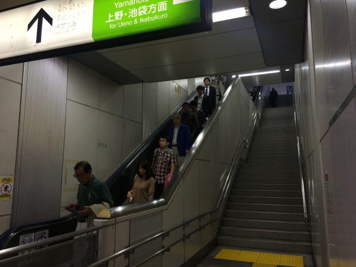 akihabara escalator moving sidewalk 700x525 - A layover in Tokyo from Haneda Airport - sushi, arcades, & beer in Akihabara