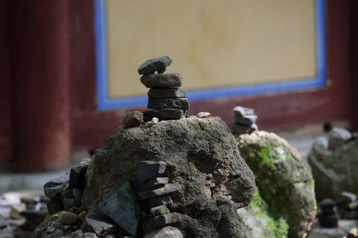 bulguksa temple stacked stones 700x467 - A day trip from Busan to Gyeongju, South Korea
