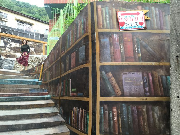 cheon deok su bookshelves 700x525 - A visit to Gamcheon Culture Village in Busan, South Korea