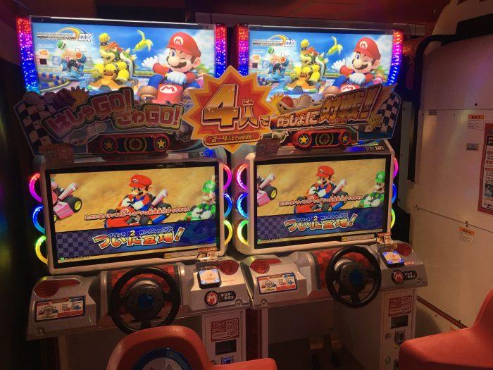 mario kart arcade game tokyo japan 700x525 - A layover in Tokyo from Haneda Airport - sushi, arcades, & beer in Akihabara