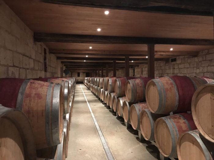 chateau de sales winery cellar 700x525 - A wine tasting tour of Bordeaux including Saint Emilion, Chateau de Sales, & Chateau de Ferrand