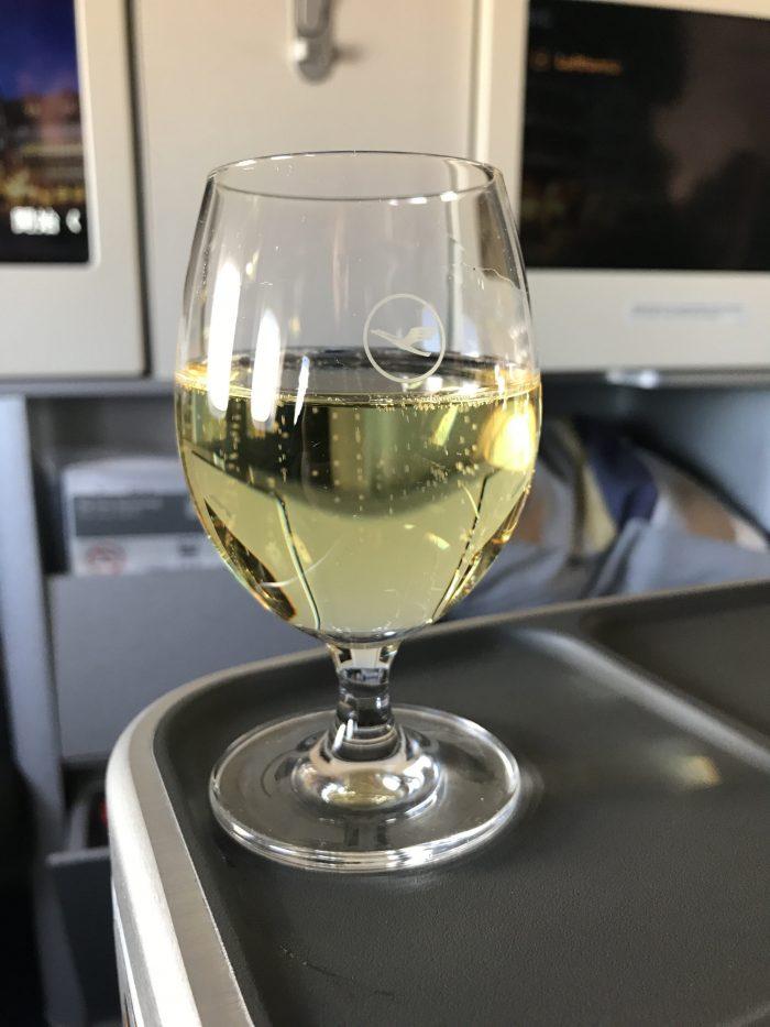 lufthansa business class boeing 747 400 denver den to frankfurt fra predeparture champagne 700x933 - Lufthansa Business Class Boeing 747-400 Denver DEN to Frankfurt FRA review