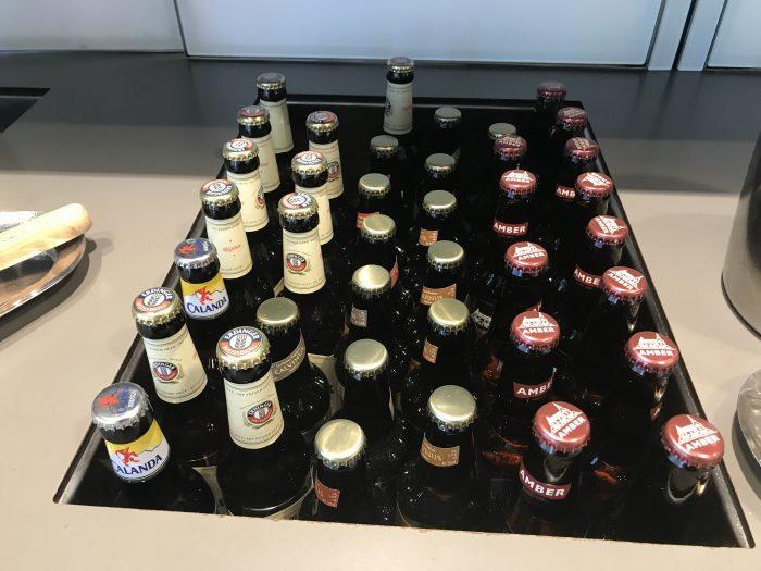 swiss business class lounge geneva airport beer 700x525 - Swiss Business Class Lounge Geneva Airport GVA review