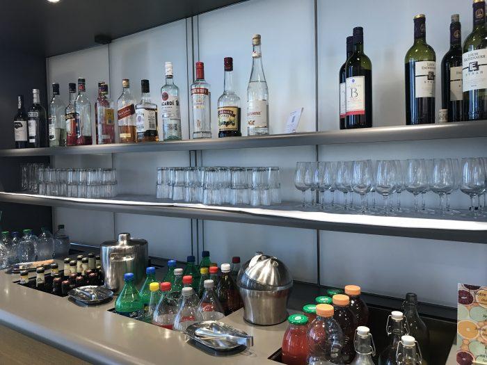 swiss business class lounge geneva airport liquor wine 700x525 - Swiss Business Class Lounge Geneva Airport GVA review