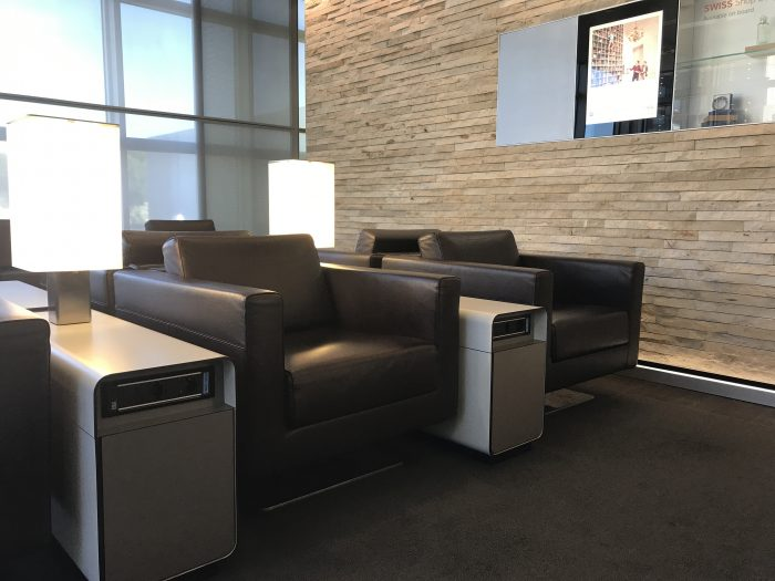 swiss business class lounge geneva airport seats 700x525 - Swiss Business Class Lounge Geneva Airport GVA review