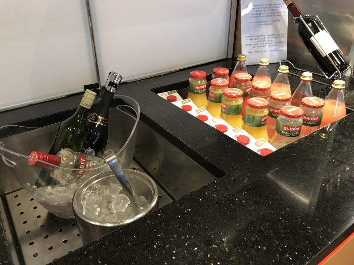 swissport horizon lounge geneva airport wine drinks 700x525 - Swissport Horizon Lounge Geneva Airport GVA review