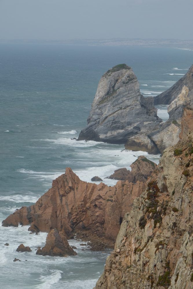 cabo da roca cliffs 667x1000 - A day trip from Lisbon to Sintra, Portugal - Sintra-Cascais Natural Park & Cabo da Roca