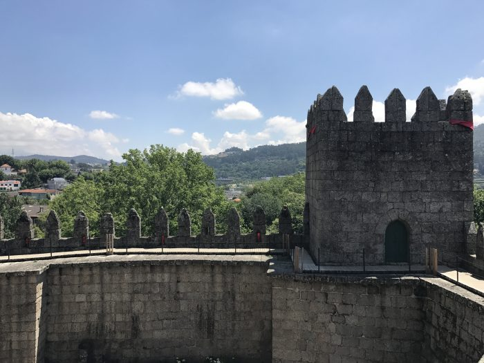 day trip to guimaraes castle walls tower 700x525 - A day trip from Porto to Guimarães, Portugal