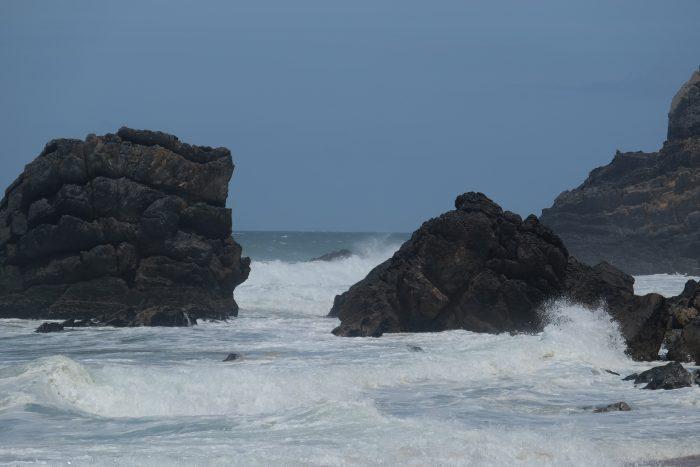 day trip to sintra cascais natural park praia da adraga rocks 700x467 - A day trip from Lisbon to Sintra, Portugal - Sintra-Cascais Natural Park & Cabo da Roca