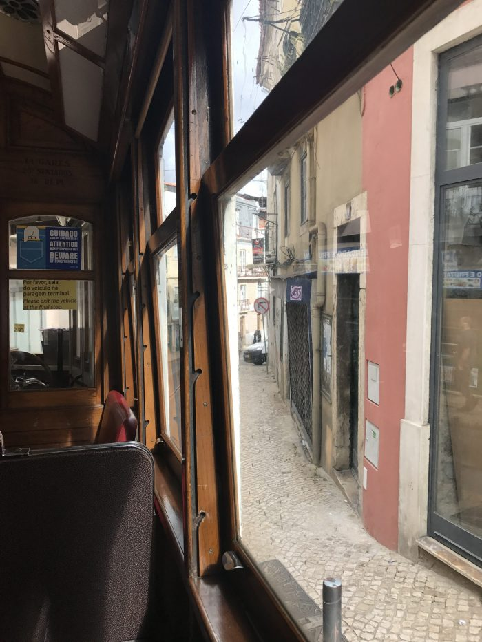 riding the tram lisbon 700x933 - The guide to Lisbon's trams including Tram 28