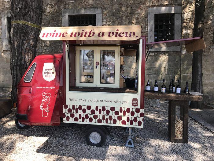 wine port cart castle sao jorge lisbon 700x525 - A visit to Sao Jorge Castle & Alfama in Lisbon, Portugal