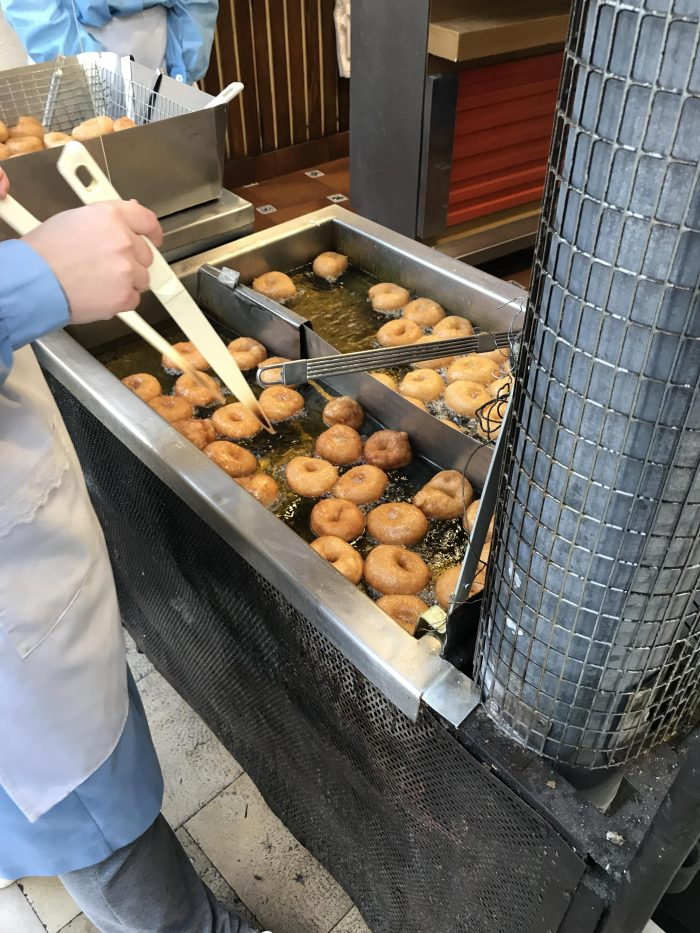 bunuelos in fryer horchateria el collado 700x933 - Horchata, fartons, & buñuelos at Horchatería El Collado in Valencia, Spain