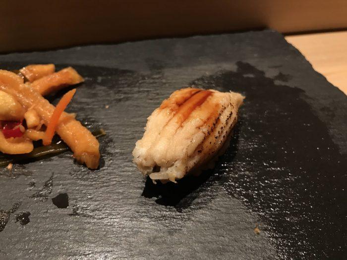 manten sushi marunouchi omakase sea eel 700x525 - Eating omakase at Manten Sushi Marunouchi in Tokyo, Japan