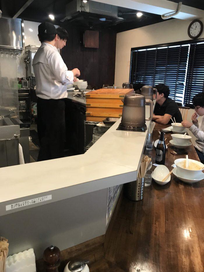 nakiryu michelin star ramen tokyo counter 700x933 - A visit to Nakiryu - Michelin-starred ramen in Tokyo, Japan
